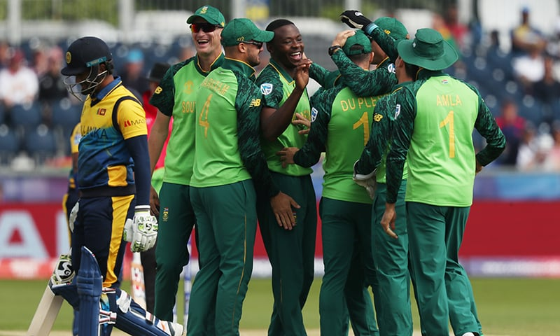 South Africa's Kagiso Rabada celebrates taking the wicket of Sri Lanka's Dimuth Karunaratne with team mates on June 28 at the Riverside Ground. — Reuters