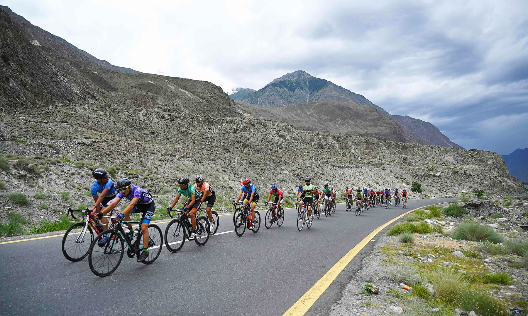 Athletes race along the Karakoram Highway in the Gilgit-Baltistan region that is located near the Chinese border. — AFP