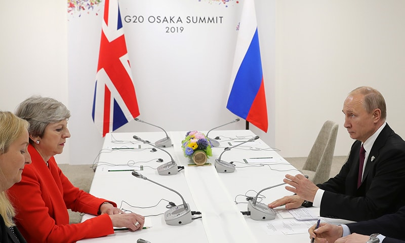 Russia's President Vladimir Putin and Britain's Prime Minister Theresa May attend a meeting on the sidelines of the G20 summit in Osaka, Japan June 28. — Reuters