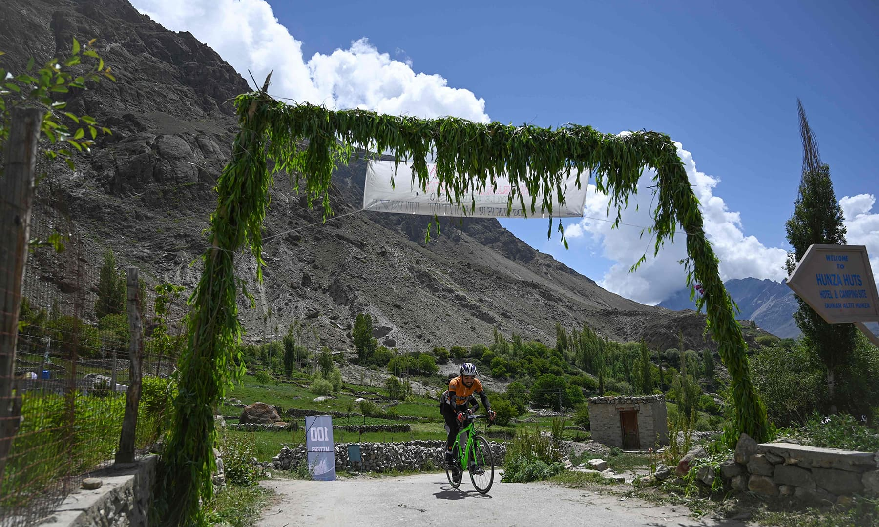 A Pakistani cyclist takes part in Tour de Khunjrab cycling race in Duikar Altit, Hunza Pakistan's northern region on June 28. — AFP