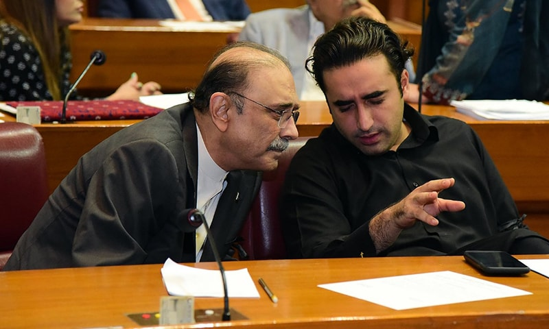 PPP's Bilawal Bhutto Zardari and Asif Ali Zardari in conversation with one another during the National Assembly session on Friday. — PPP media cell