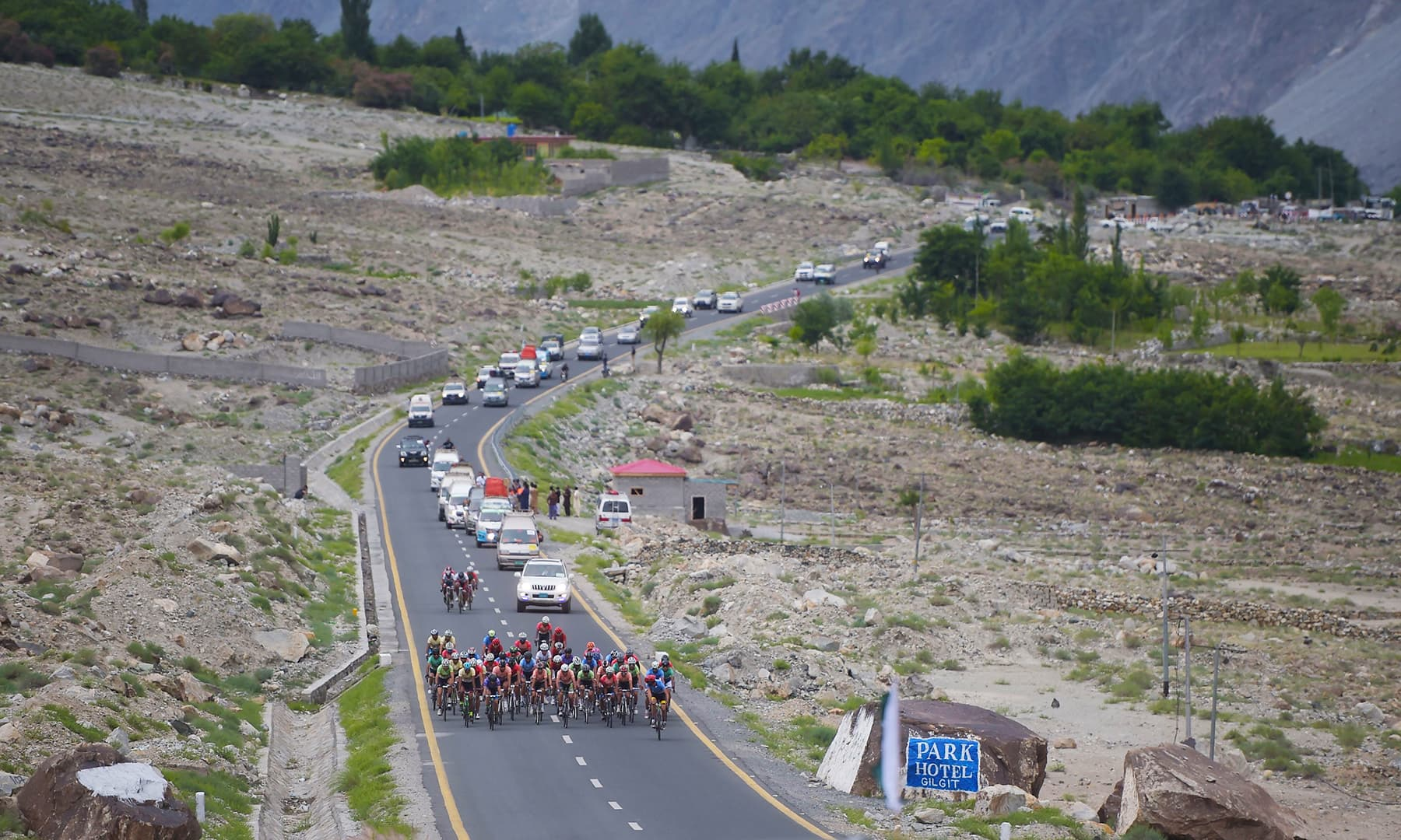 In this picture taken on June 27, Pakistani and international cyclists take part in Tour de Khunjrab cycling race on Karakoram Highway near Gilgit city. — AFP