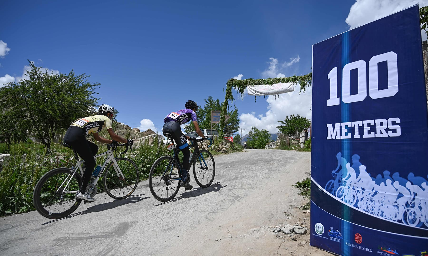 Pakistani cyclist takes part in Tour de Khunjrab cycling race in Duikar Altit, Hunza on June 28. — AFP