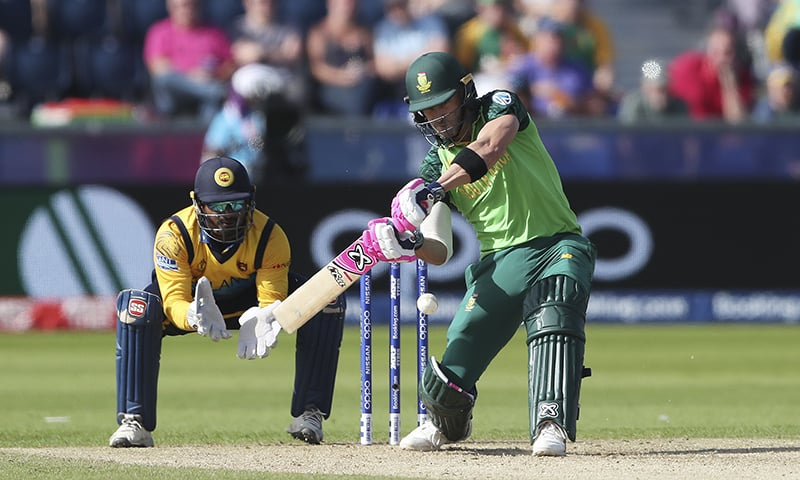 South Africa's captain Faf du Plessis (R) plays a shot as Sri Lanka's wicketkeeper Kusal Perera watches on during the Cricket World Cup match between Sri Lanka and South Africa at the Riverside Ground in Chester-le-Street on June 28. — AP