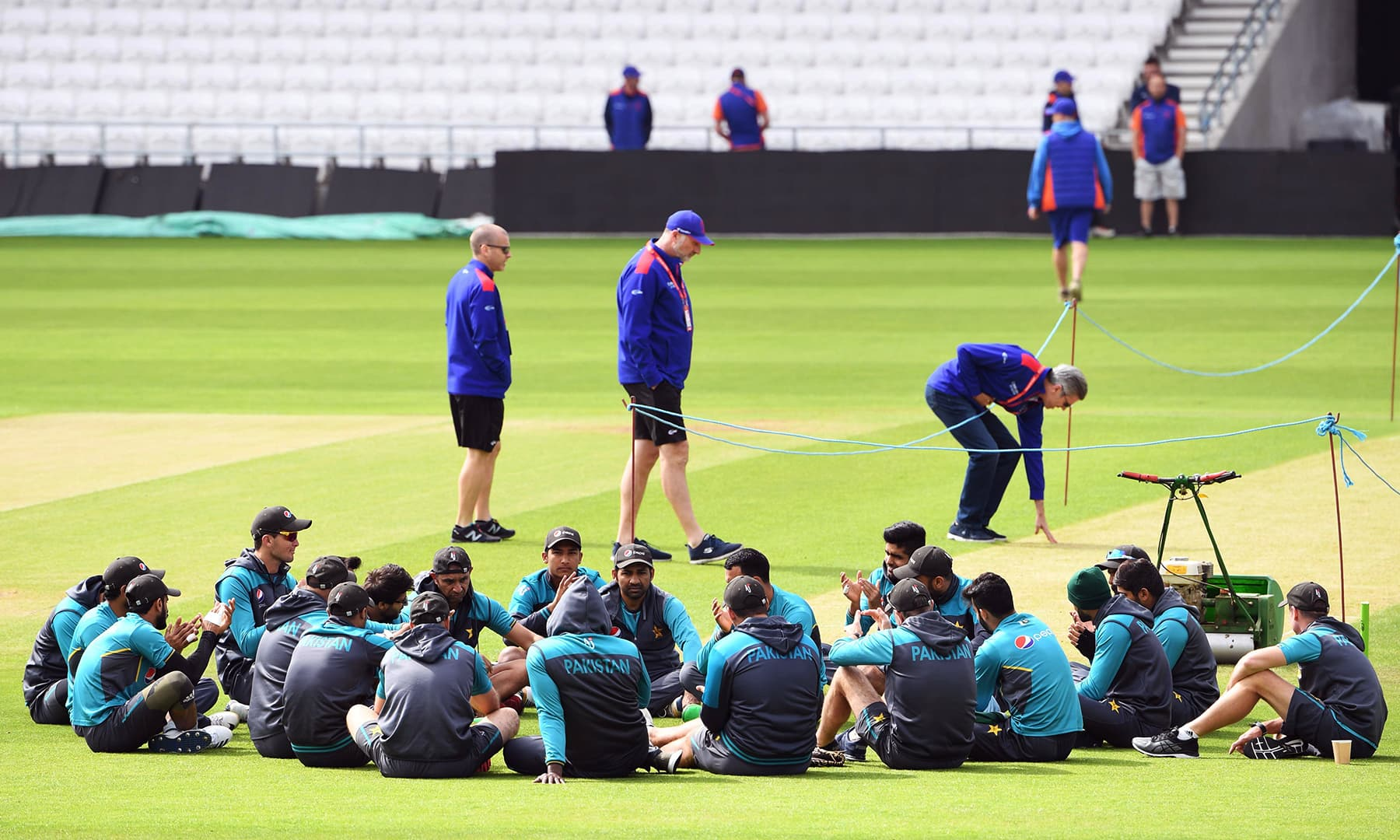 Skipper Sarfaraz Ahmed (C) speaks to his team on the field during a training session at Headingley in Leeds, northern England, ahead of their World Cup cricket match against Afghanistan on June 28. — AFP