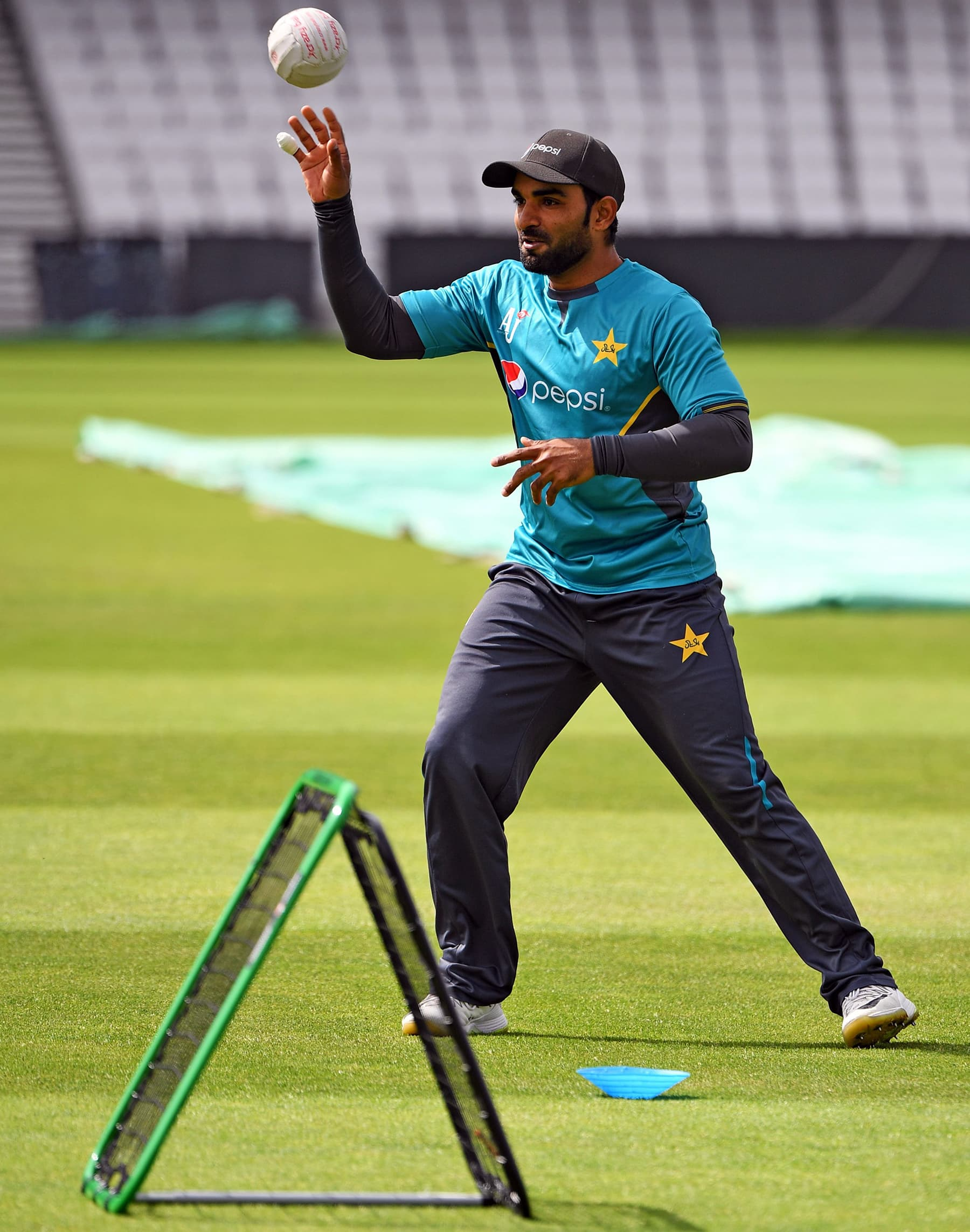 Asif Ali takes the ball during the training session at Headingly. — AFP