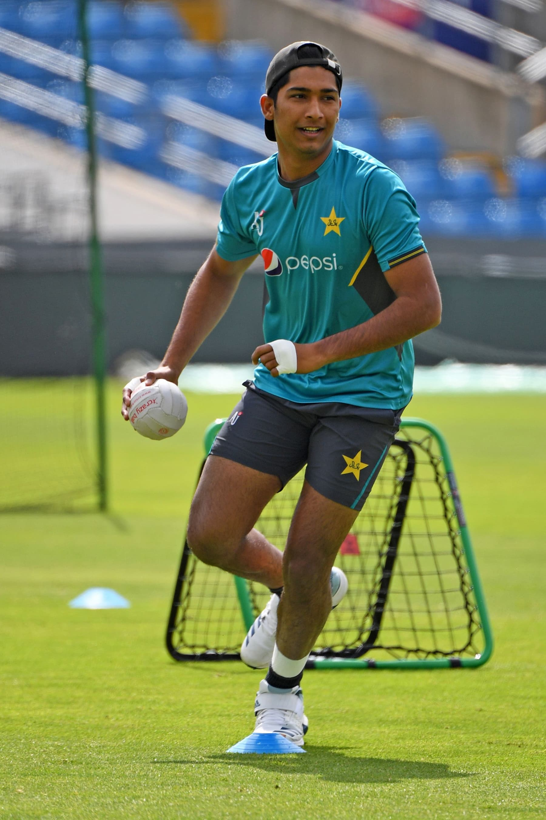 Mohammad Hasnain takes hold of the ball during the team training session at Headingly. — AFP