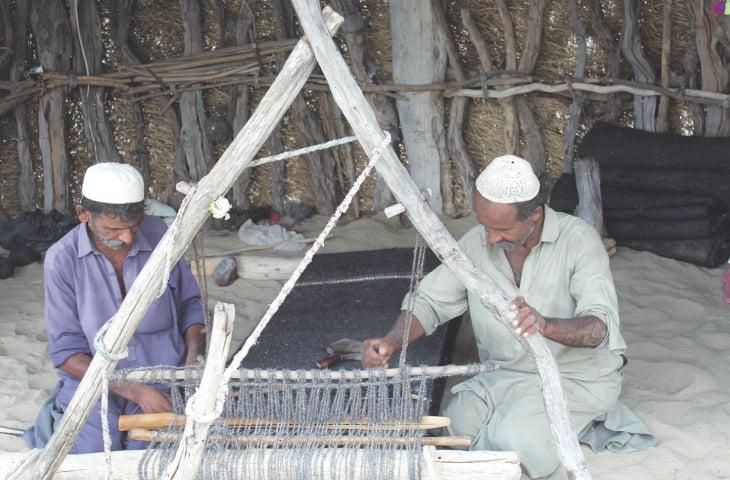 Aarab and Malhar making a khaes on a loom
