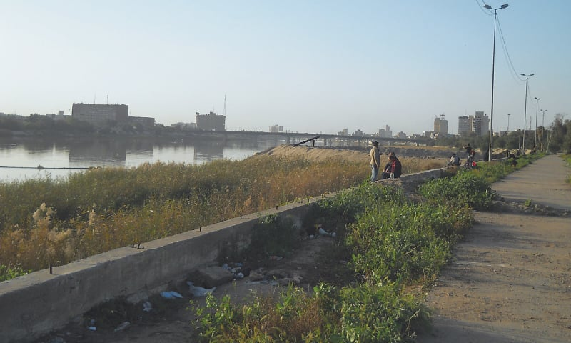 A bridge on the River Tigris, downtown Baghdad in the background