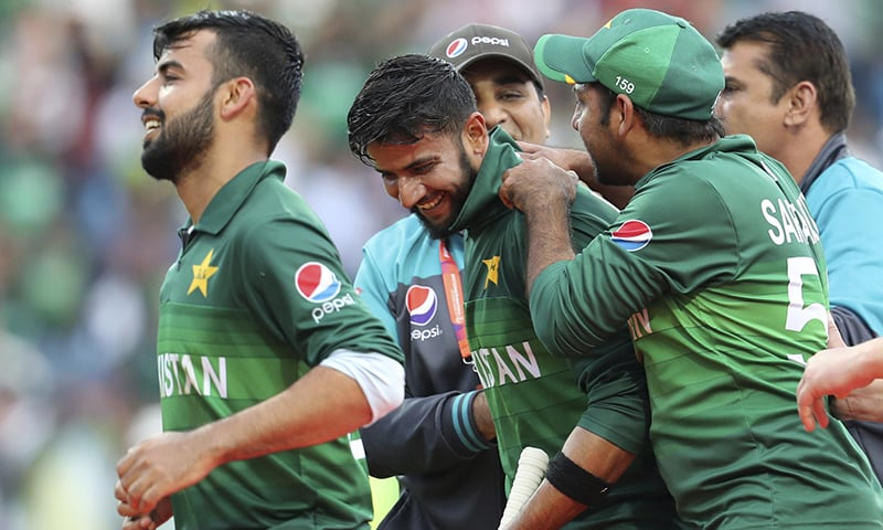 Pakistan celebrate their victory in the Cricket World Cup match against Afghanistan at Headingley in Leeds, England, Saturday, June 29. — AP