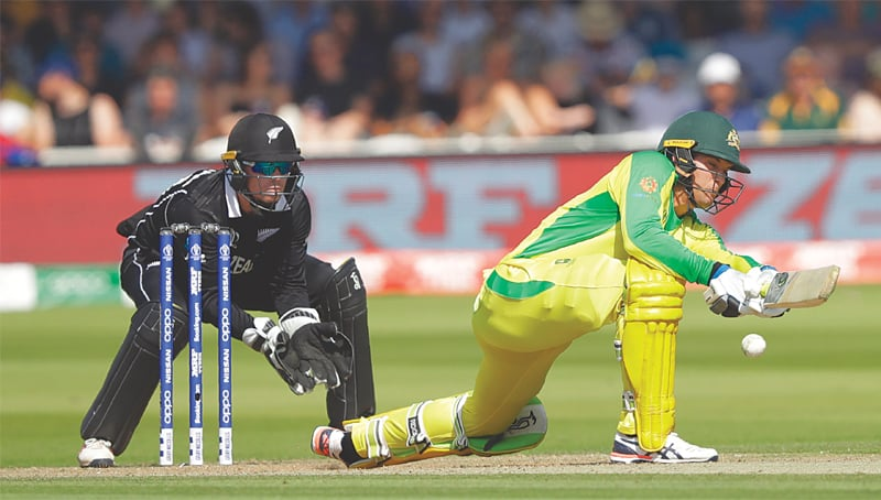 LONDON: Australia's Alex Carey plays a shot as New Zealand wicket-keeper Tom Latham looks on during their match at Lord's on Saturday.—AP