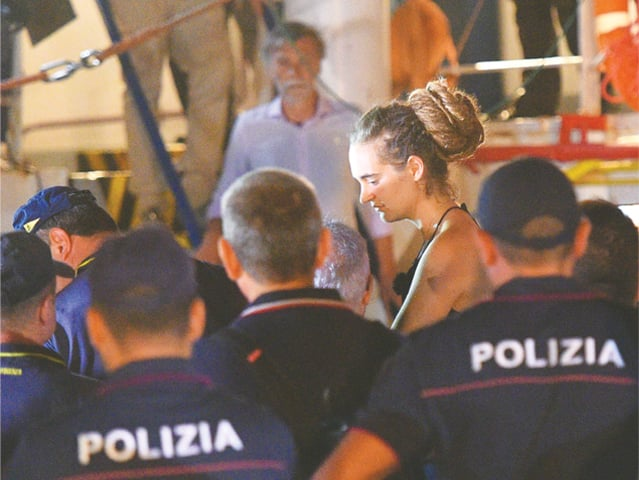 Lampedusa (Italy): Carola Rackete, the 31-year-old Sea-Watch 3 captain, is escorted off the ship by police and taken away for questioning on Saturday.—Reuters