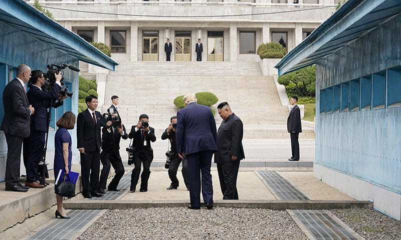 US President Donald Trump meets with North Korean leader Kim Jong Un at the Demilitarized Zone separating the two Koreas, in Panmunjom, South Korea on June 30. — Reuters