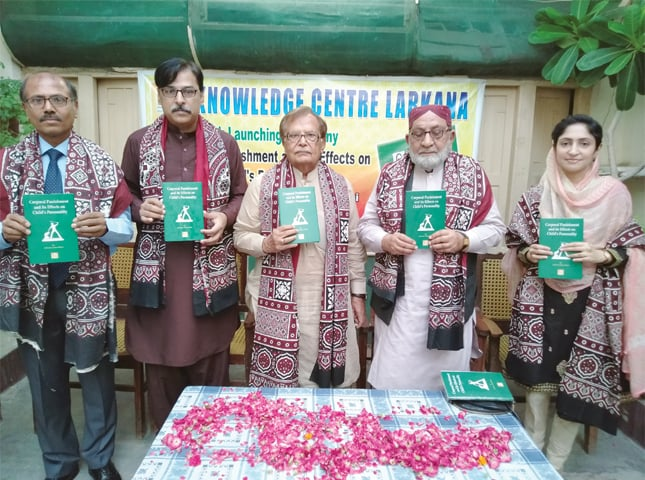 AUTHOR (extreme right) and guests hold copies of the book at the launching ceremony.—Dawn