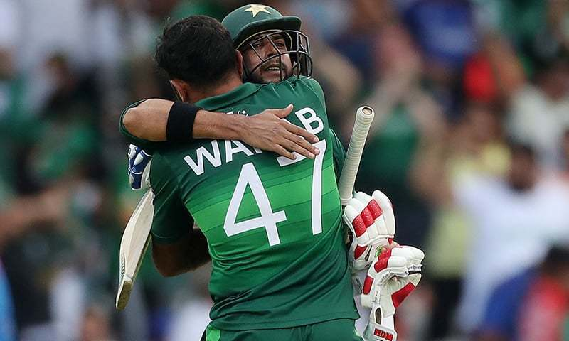 Allrounder Imad Wasim hugs fast bowler Wahab Riaz after hitting the winning boundary in Pakistan's World Cup match against Afghanistan on Saturday. — Reuters/File