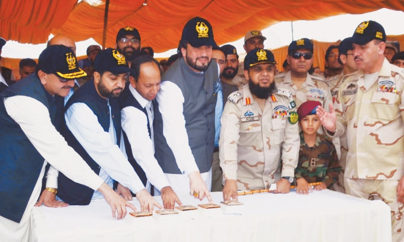 QUETTA: Minister for States and Frontier Regions Shehryar Khan Afridi, Balochistan Home Minister Mir Ziaullah Langove, Health Minister Mir Naseebullah Khan Marri and others push buttons to burn drugs seized by the Anti-Narcotics Force and Balochistan Frontier Corps during a raid at the Kach Morr area on Monday. — Online