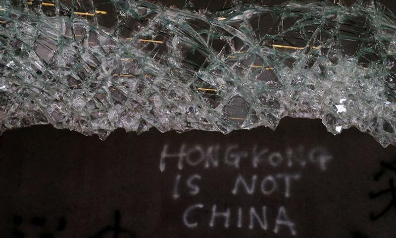 Broken glass and graffiti are seen at the Legislative Council, a day after protesters broke into the building in Hong Kong, China on July 2. — Reuters