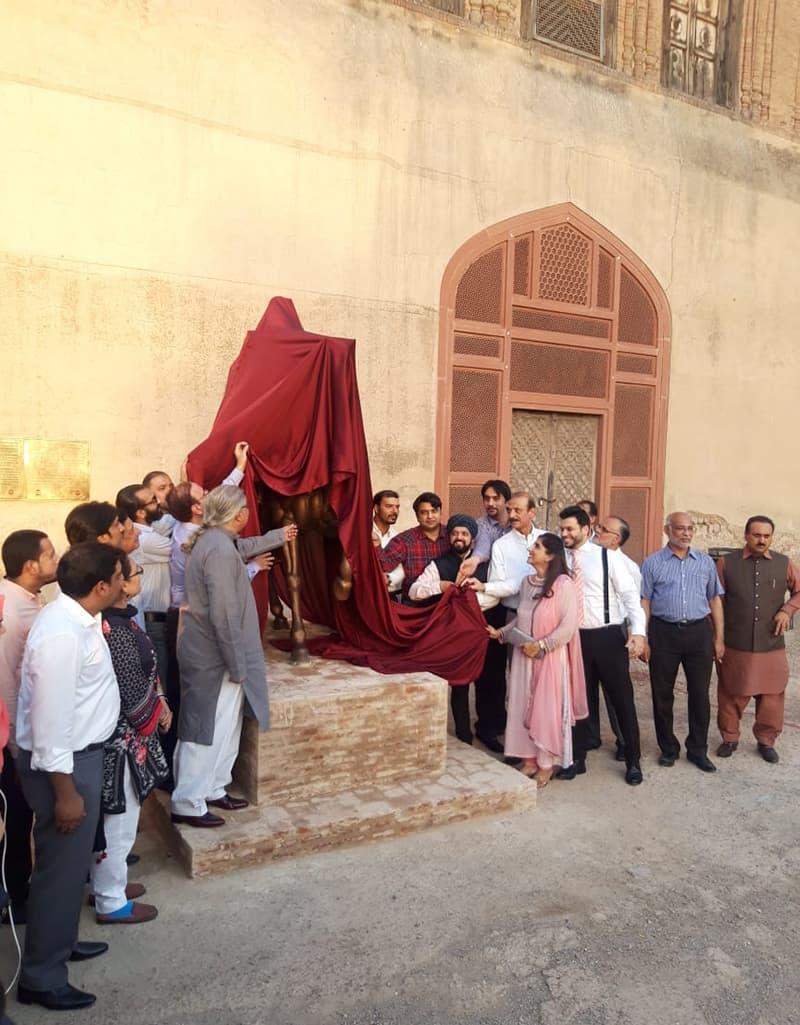 Punjab Tourism Minister Raja Yasir Humayun Sarfraz, WCLA officials and visitors from Amritsar at the inauguration of the Maharaja Ranjit Singh statue in Lahore last week.—Photo via Press Information Department on Twitter