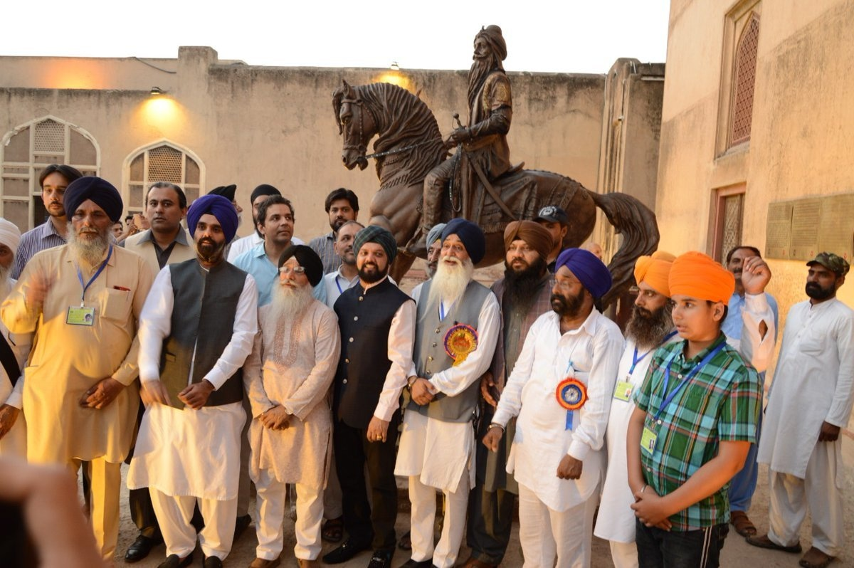 Punjab Tourism Minister Raja Yasir Humayun Sarfraz, WCLA officials and visitors from Amritsar at the inauguration of the Maharaja Ranjit Singh statue in Lahore last week.—Photo via Press Information Department on Twitter