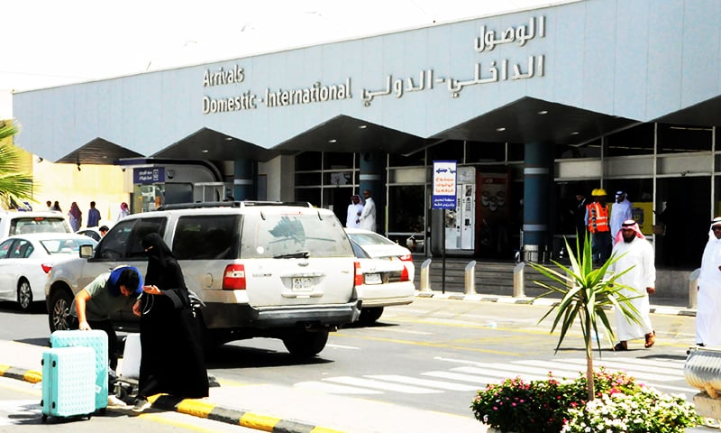 Travellers gather in front of the arrivals lounge at the Abha airport in the southern Saudi Arabian popular mountain resort of the same name, on July 2, 2019. — AFP