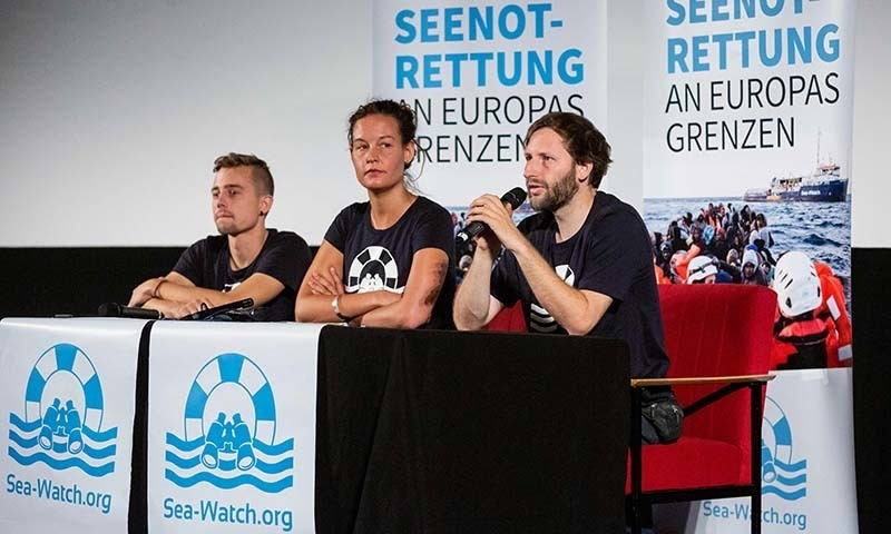 (L-R) Ship media coordinator at Sea-Watch Chris Grodotzki, head of political public relations at Sea-Watch Marie Naaß and speaker of Sea-Watch Ruben Neugebauer address a press conference about Sea-Watch captain C. Rakete in Berlin on July 2. — AFP
