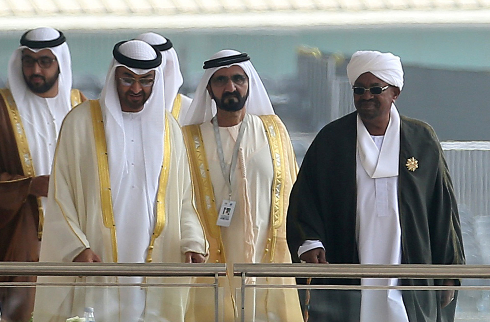 Abu Dhabi Crown Prince Sheikh Mohammed bin Zayed Al Nahyan (second from left) and Sudanese leader Bashir (right) attend a defence exhibition and conference in Abu Dhabi in February 2017. ─ Reuters