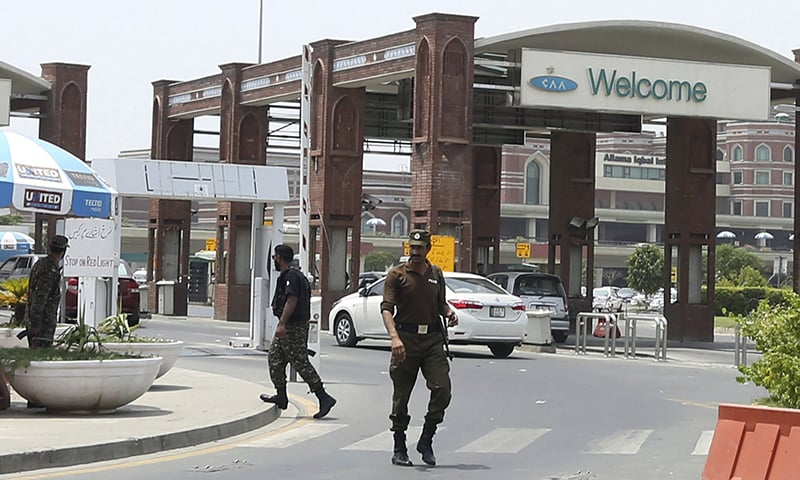 Security troops patrol outside the main terminal of Lahore's international airport on Wednesday. — AP