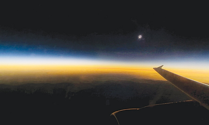 A VIEW of the solar eclipse from an airliner flying over La Serena, Chile. — AFP