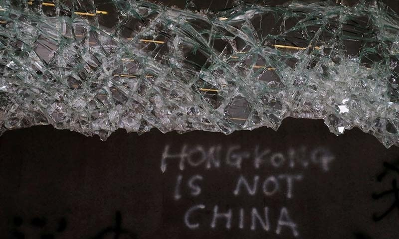 In this file photo, broken glass and graffiti are seen at the Legislative Council, a day after protesters broke into the building in Hong Kong, China on July 2.  — Reuters