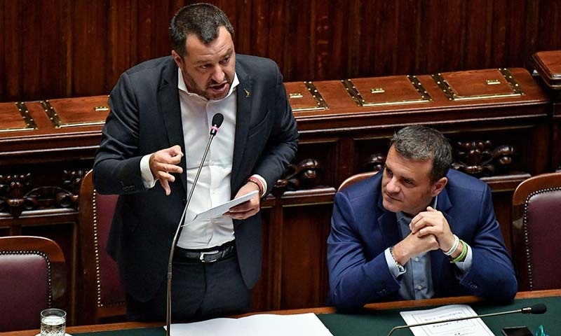 Italian Deputy Premier and Interior Minister Matteo Salvini, left, is flanked by the Minister For Agricultural Resources ,Gian Marco Centinaio, as he addresses the Lower Chamber in Rome on Wednesday. —  Alessandro Di Meo/ANSA via AP