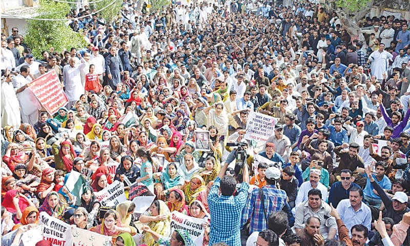 MEMBERS of the Hindu community from Kohistan stage a rally in Hyderabad on Thursday.—Dawn