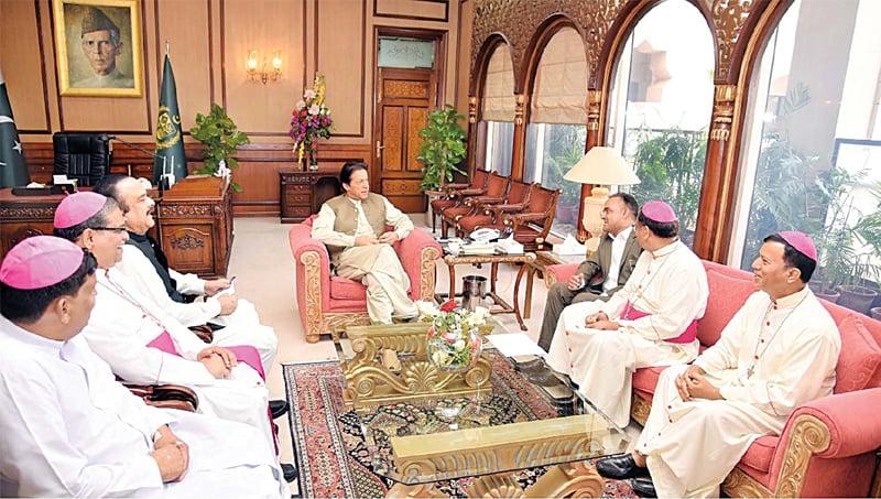 Prime Minister Imran Khan speaks to a delegation of bishops, led by MNA Jamshed Thomas. — PPI