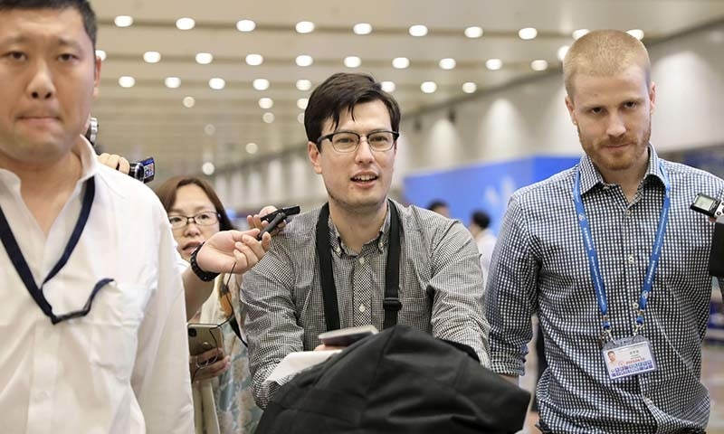 An Australian student Alek Sigley, 29,  who was detained in North Korea, arrives at Beijing international airport in Beijing, China on July 4. — Kyodo via Reuters