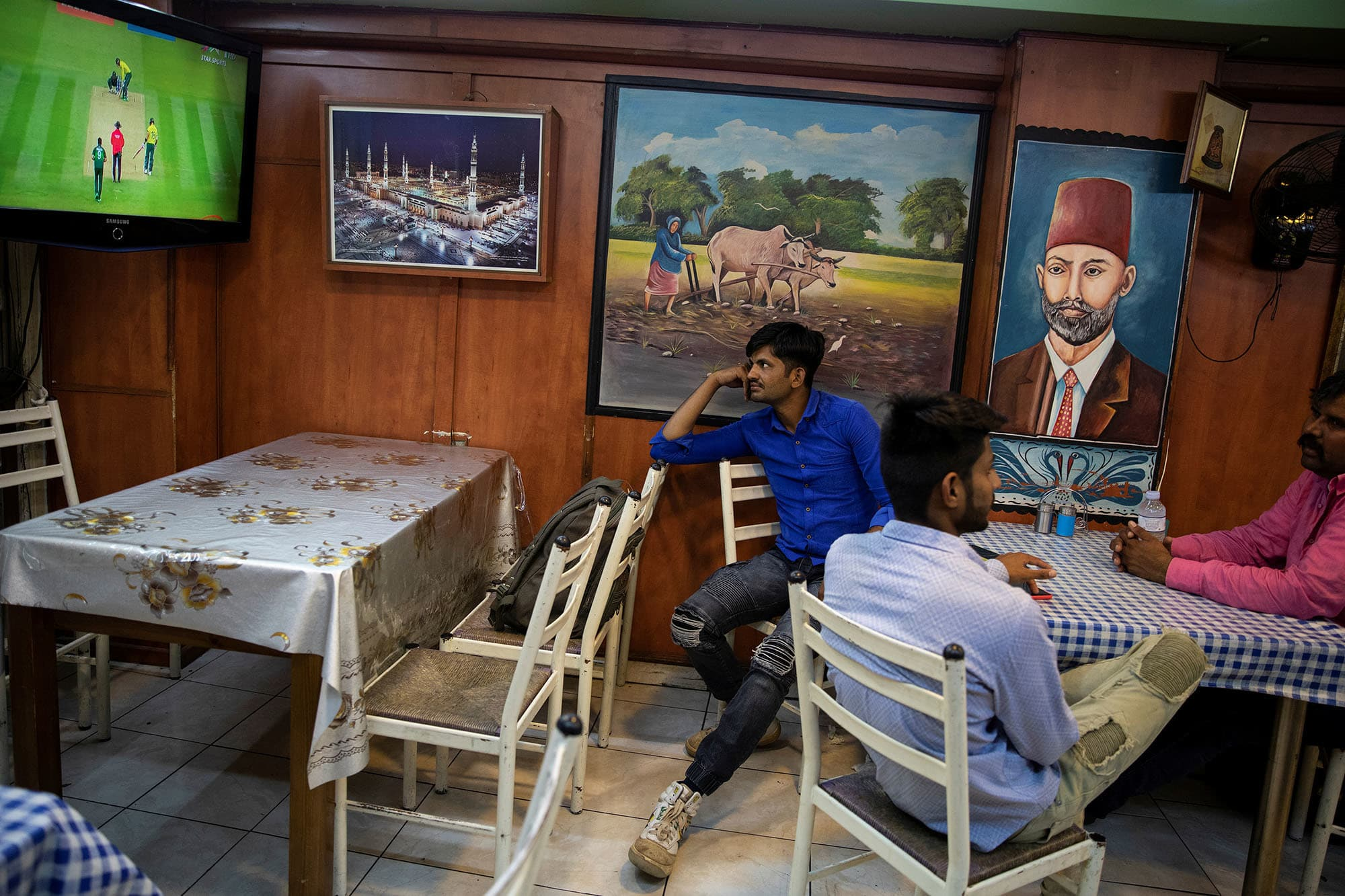 A Pakistani man living in Greece watches his national cricket team's World Cup game against South Africa in a restaurant in central Athens, Greece on June 23. — Reuters