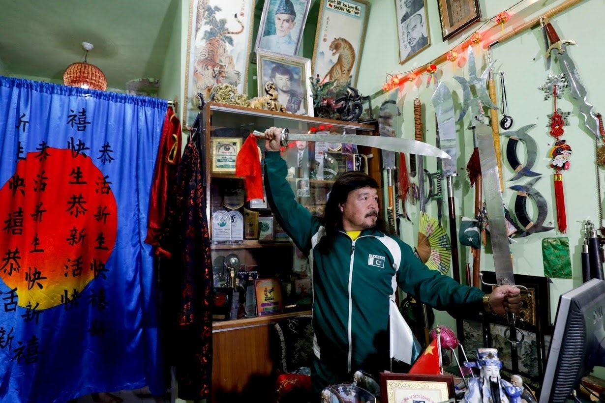 Shaolin Kung Fu Grandmaster Mubarak Ali Shan poses for a photograph at his office. ─ Reuters