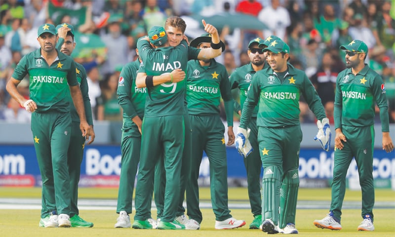 LONDON: Shaheen Afridi embraces a teammate and gives a thumbs-up as he celebrates the dismissal of Bangladesh's Mahmudullah.—AP