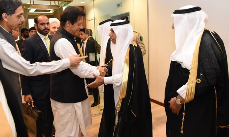 Prime Minister Imran Khan meets Saudi officials during inauguration of 'Road to Makkah' programme at Islamabad International Airport on Friday.