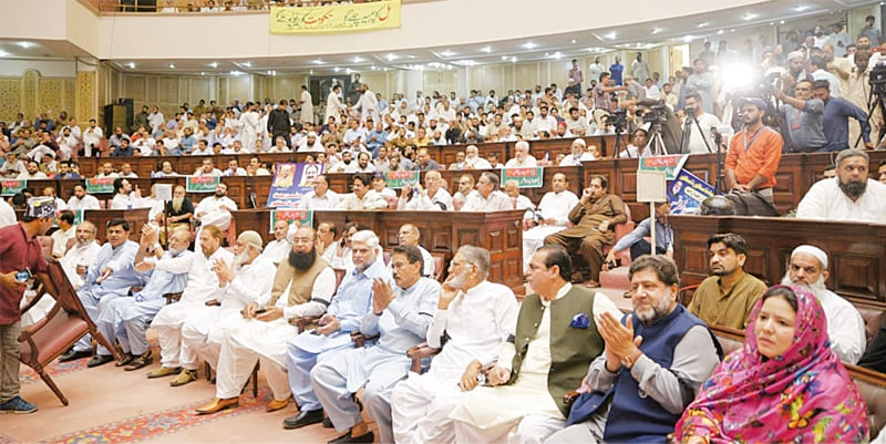LAHORE: Traders attend a conference at Aiwan-i-Iqbal Complex on Friday. They urged the government to immediately withdraw sales tax on zero-rated sectors.