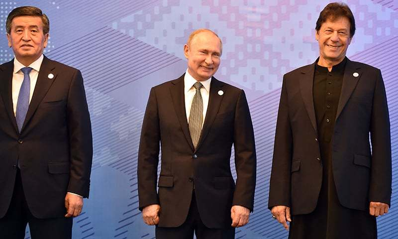 From L: Kyrgyz President Sooronbai Jeenbekov, Russian President Vladimir Putin and Pakistani Prime Minister Imran Khan pose for a photo prior to a meeting of the Shanghai Cooperation Organisation (SCO) Council of Heads of State in Bishkek on June 14, 2019. (Photo by Vyacheslav OSELEDKO / AFP) — AFP or licensors