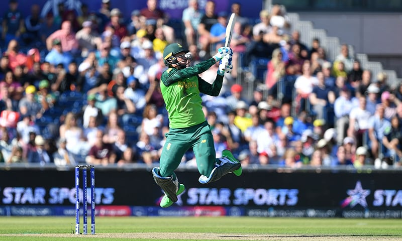South Africa's Rassie van der Dussen leaps in the air as he attempts to hit a six off the last ball of his team's innings and was caught on the boundary during the 2019 Cricket World Cup group stage match between Australia and South Africa at Old Trafford in Manchester, northwest England, on July 6. — AFP