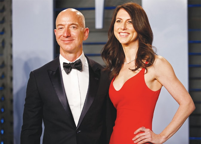This March 4, 2018 file photo shows Amazon CEO Jeff and wife MacKenzie Bezos during Vanity Fair Oscar Party Arrivals at Beverly Hills, California.—Reuters