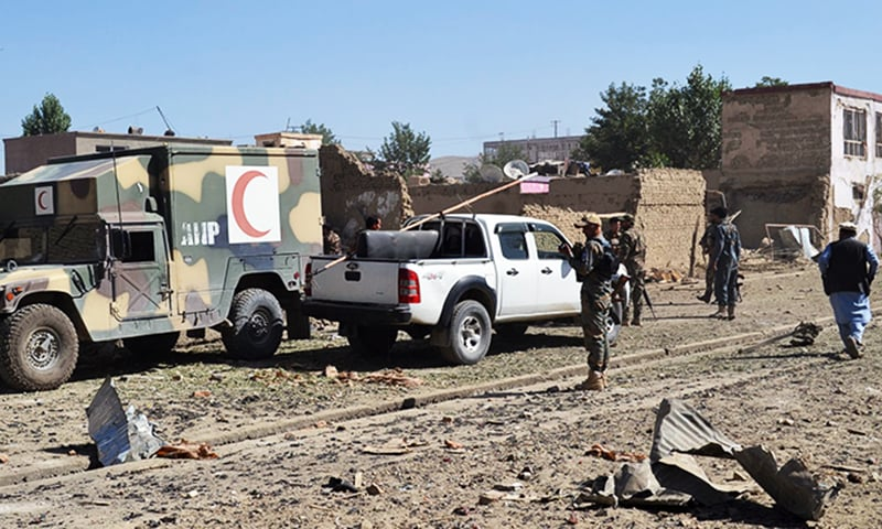Afghan security personnel arrive at the site of a car bomb attack that targeted an intelligence unit in Ghazni. — AFP