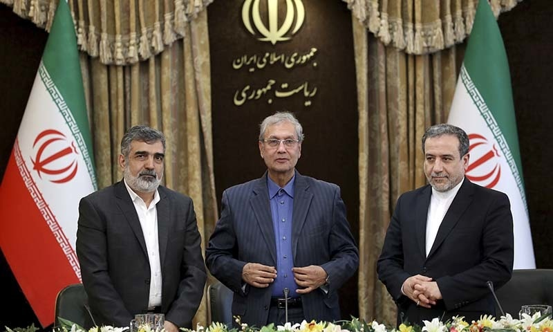 From left to right, spokesman for Iran's atomic agency Behrouz Kamalvandi, Iran's government spokesman Ali Rabiei and Iranian Deputy Foreign Minister Abbas Araghchi, attend a press briefing in Tehran, Iran on Sunday. — AP