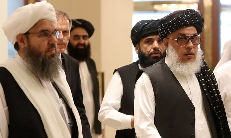 The Taliban's former envoy to Saudi Arabia Shahabuddin Delawar (L) arrives with Taliban negotiator Abbas Stanikzai (R), along with Taliban Qatar spokesman Suhail Shaheen (2nd-R), and the Taliban's former culture and information minister Amir Khan Mutaqi to attend the Intra Afghan Dialogue talks in the Qatari capital Doha on Sunday. — AFP