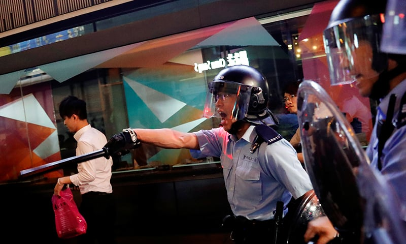Riot police try to disperse anti-extradition bill protesters after a march at Hong Kong's tourism district Nathan Road near Mongkok, China July 7. — Reuters