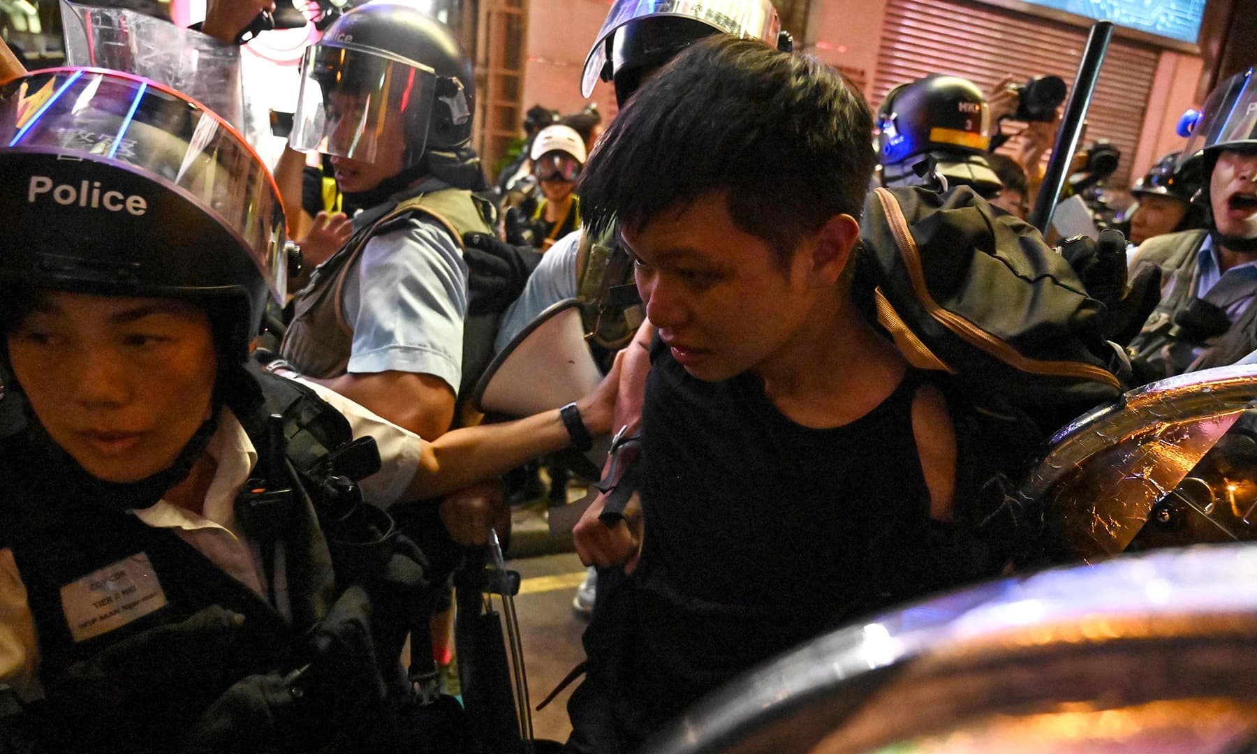Police arrest protesters during a clash in the Mong Kok district in Kowloon after a march to the West Kowloon rail terminus against the proposed extradition bill in Hong Kong on July 7. — AFP