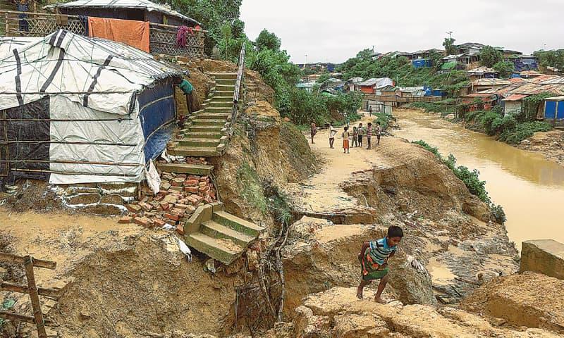 Rohingya children walk around an area hit by landslides near a refugee camp in Bangladesh. — AFP