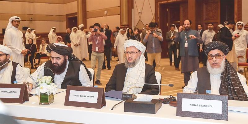 DOHA: Amir Khan Mutaqi (left), Abdul Salam Hanafi (centre) and Abbas Stanekzai, all members of the Taliban delegation, attending the intra-Afghan dialogue.—AFP