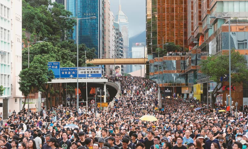 HONG KONG: Protesters march to a train station in this city's tourism district.—Reuters