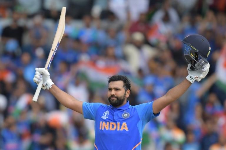 India's Rohit Sharma celebrates after reaching his century against Sri Lanka. ─ AFP